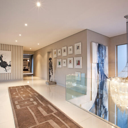 The top portion of a huge, multi-panel installation of different sized canvasses for the entrance to an exclusive home commissioned by a prolific interior designer. The canvasses fitted together like a jigsaw puzzle adding to its individuality.